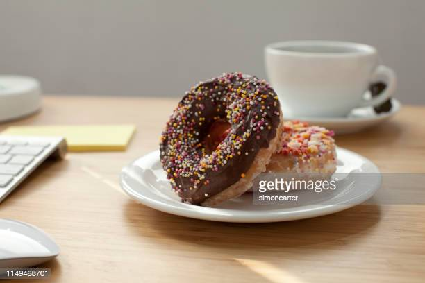 Doughnuts on a plate. Home office interior.