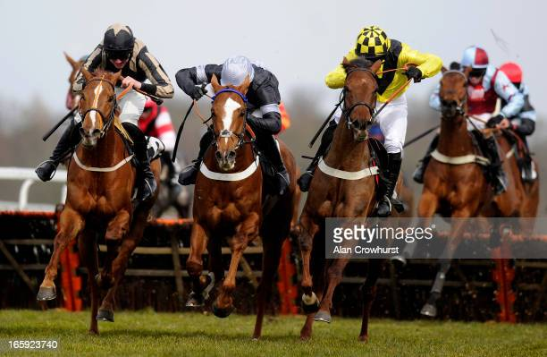 Dougie Costello riding Calculated Risk clear the last to win The Huge Juvenile Handicap Hurdle Race at Ascot racecourse on April 07 2013 in Ascot...
