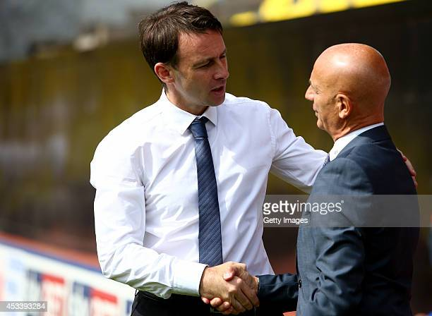 Dougie Freedman manager of Bolton Wanderers greets Bebbe Sannino manager of Watford before the Sky Bet Championship match between Watford and Bolton...