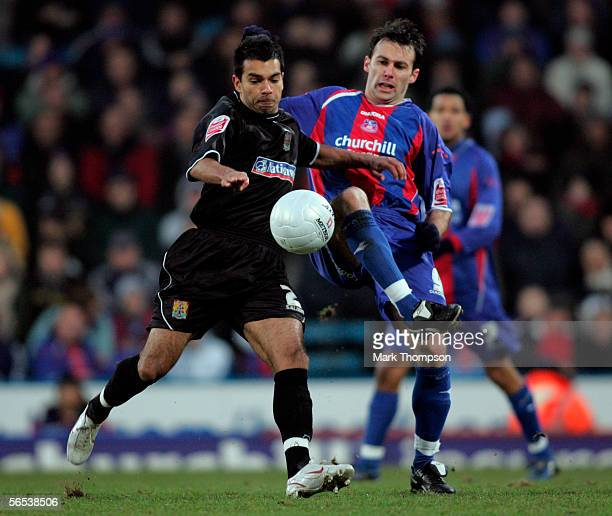 Dougie Freedman of Crystal Palace and Jason Crowe of Northampton battle for the ball during the FA Cup Third Round match between Crystal Palace and...