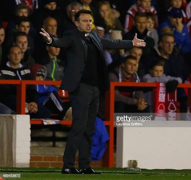 Dougie Freedman of Nottingham Forest gestures from the bench during the Sky Bet Championship match between Nottingham Forest and Burnley at City...