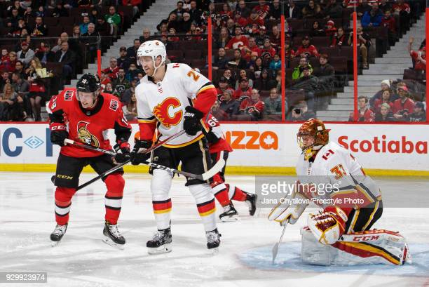 Dougie Hamilton and David Rittich of the Calgary Flames defend against Ryan Dzingel of the Ottawa Senators in the second period at Canadian Tire...