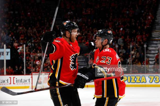 Dougie Hamilton and Sean Monahan of the Calgary Flames celebrate a goal against the Florida Panthers during an NHL game on February 17 2018 at the...