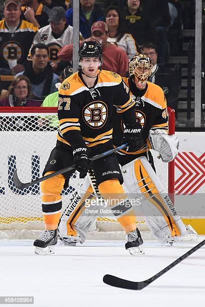 Dougie Hamilton and Tuukka Rask of the Boston Bruins watch the play against the Florida Panthers at the TD Garden on November 4 2014 in Boston...