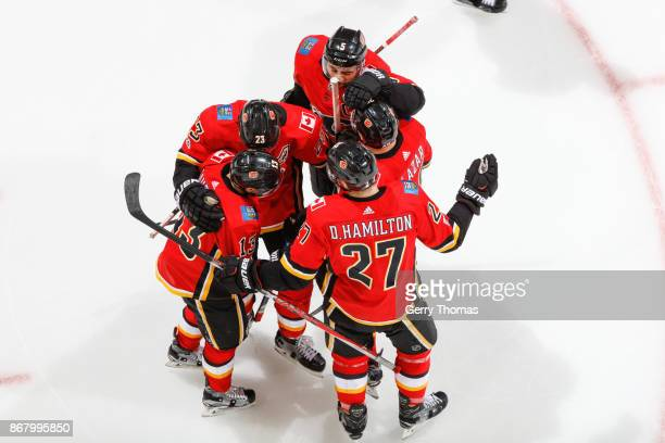 Dougie Hamilton Johnny Gaudreau Mark Giordano Sean Monahan and Curtis Lazar the Calgary Flames celebrate after scoring a second goal an NHL game...