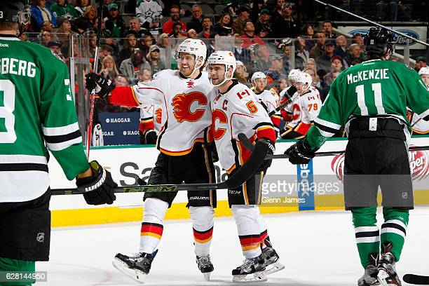 Dougie Hamilton Mark Giordano and the Calgary Flames celebrate a goal against the Dallas Stars at the American Airlines Center on December 6 2016 in...