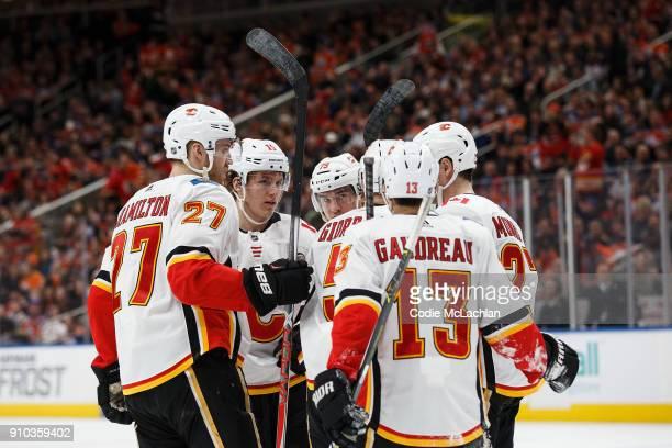 Dougie Hamilton Matthew Tkachuk Micheal Ferland Sean Monahan Johnny Gaudreau and Mark Giordano of the Calgary Flames celebrate Giordano's goal...