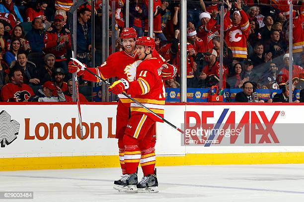 Dougie Hamilton Mikael Backlund and teammates of the Calgary Flames celebrate a goal against the Winnipeg Jets during an NHL game on December 10 2016...