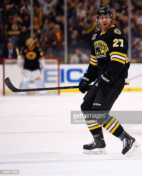 Dougie Hamilton of the Boston Bruins celebrates an assist on his teams goal in the third period against the Montreal Canadiens during the game at TD...