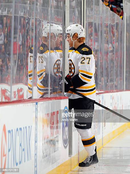 Dougie Hamilton of the Boston Bruins heads into the penalty after being called for a hooking penalty against the New Jersey Devils during the game at...