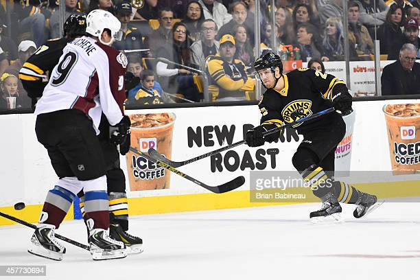 Dougie Hamilton of the Boston Bruins shoots the puck against the Colorado Avalanche at the TD Garden on October 13 2014 in Boston Massachusetts