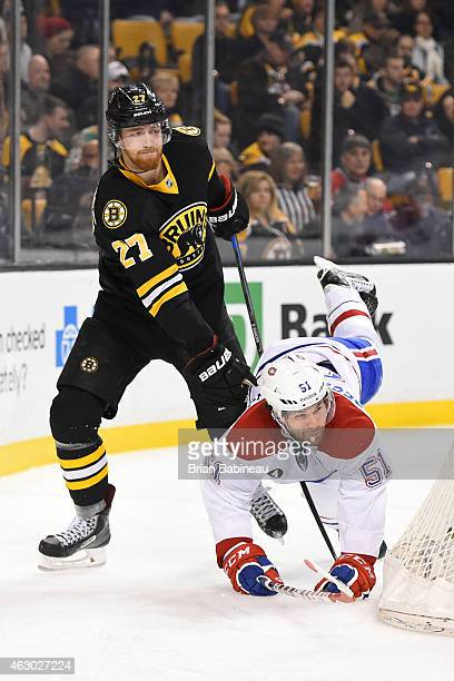 Dougie Hamilton of the Boston Bruins skates against David Desharnais of the Montreal Canadiens at the TD Garden on February 8 2015 in Boston...