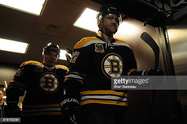 Dougie Hamilton of the Boston Bruins walks to the ice for warm ups before the game against the Phoenix Coyotes at the TD Garden on March 13 2014 in...