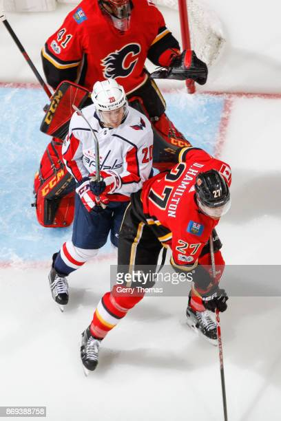 Dougie Hamilton of the Calgary Flames and Lars Eller of the Washington Capitals are looking for a shoot in an NHL game against the Washington...