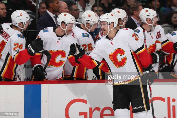 Dougie Hamilton of the Calgary Flames celebrates a goal against the Colorado Avalanche with his bench at the Pepsi Center on November 25 2017 in...