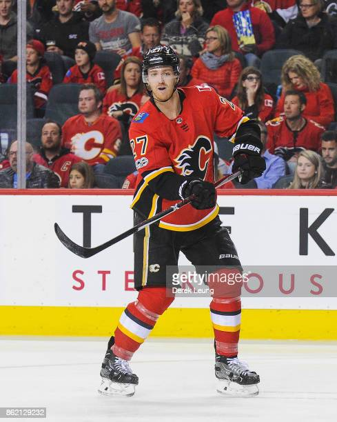 Dougie Hamilton of the Calgary Flames in action Ottawa Senators during an NHL game at Scotiabank Saddledome on October 13 2017 in Calgary Alberta...