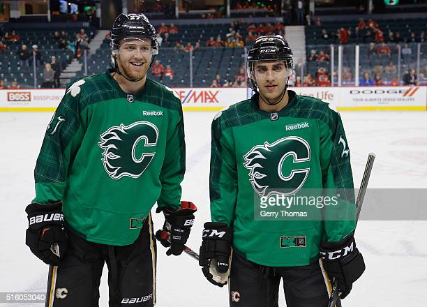 Dougie Hamilton of the Calgary Flames is reunited with his brother Freddie Hamilton for the game against the Winnipeg Jets at Scotiabank Saddledome...