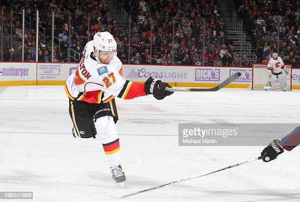 Dougie Hamilton of the Calgary Flames shoots against the Colorado Avalanche at the Pepsi Center on November 3 2015 in Denver Colorado The Avalanche...