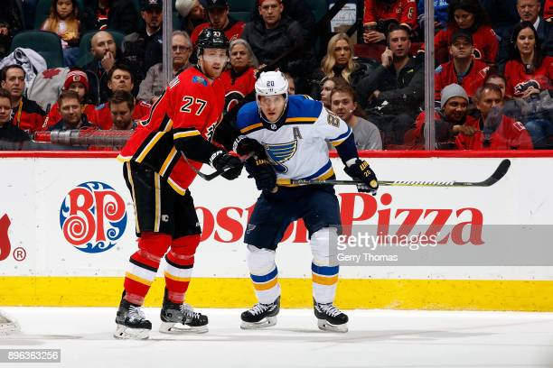 Dougie Hamilton of the Calgary Flames skates against Alex Steen of the St Louis Blues during an NHL game on December 20 2017 at the Scotiabank...