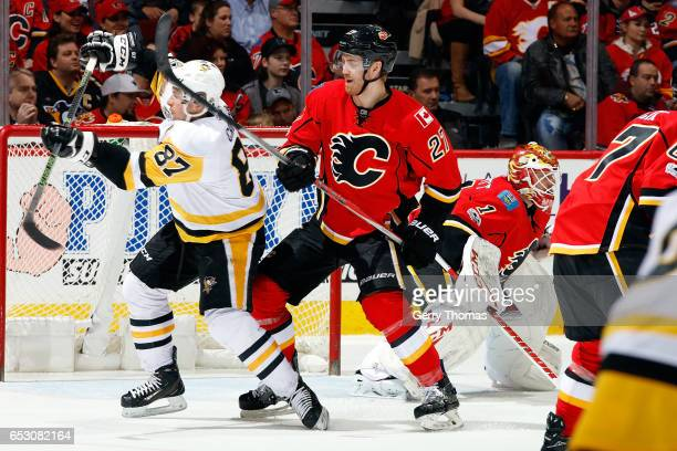 Dougie Hamilton of the Calgary Flames skates against Sidney Crosby of the Pittsburgh Penguins during an NHL game on March 13 2017 at the Scotiabank...