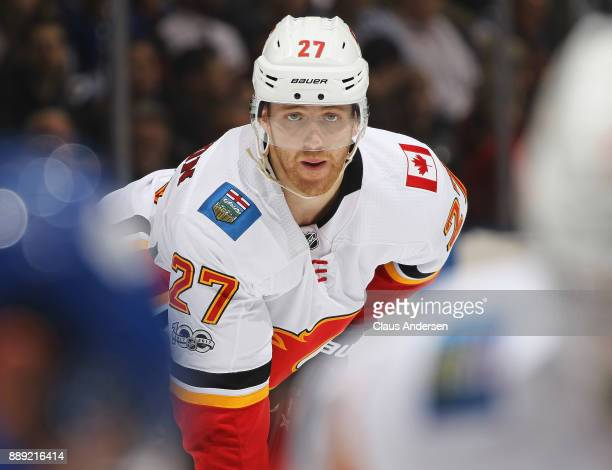 Dougie Hamilton of the Calgary Flames waits for a faceoff against the Toronto Maple Leafs during an NHL game at the Air Canada Centre on December 6...