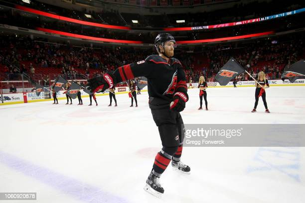 Dougie Hamilton of the Carolina Hurricanes celebrates a victory following an NHL game against the San Jose Sharks on October 26 2018 at PNC Arena in...