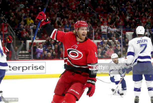 Dougie Hamilton of the Carolina Hurricanes celebrates after scoring a goal during an NHL game against the Tampa Bay Lightning on March 21 2019 at PNC...