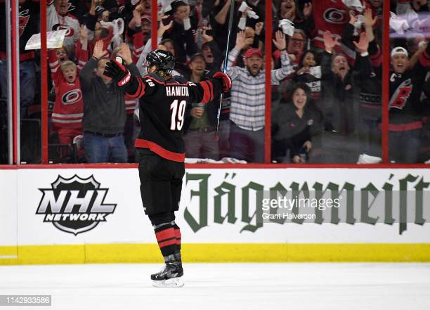 Dougie Hamilton of the Carolina Hurricanes celebrates after scoring a goal against the Washington Capitals during the second period in Game Three of...