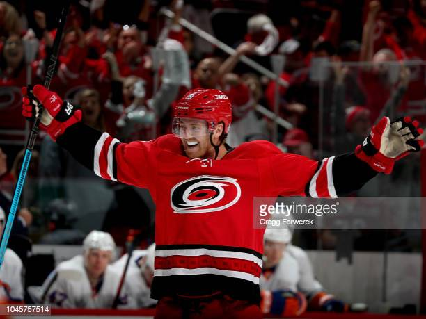 Dougie Hamilton of the Carolina Hurricanes celebrates his assist on a goal scored by teammate Jordan Staal not pictured during an NHL game against...