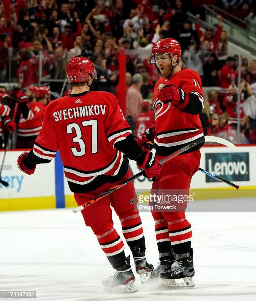 Dougie Hamilton of the Carolina Hurricanes celebrates with teammate Andrei Svechnikov after scoring a goal during an NHL game against October 6 2019...