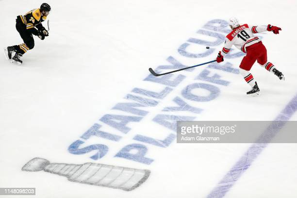 Dougie Hamilton of the Carolina Hurricanes chases the puck during the first period against the Boston Bruins in Game One of the Eastern Conference...