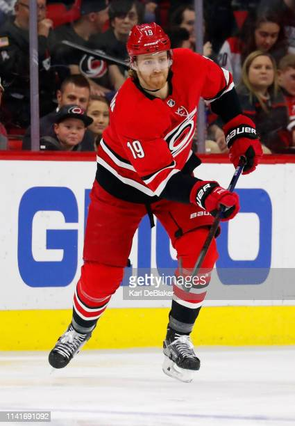 Dougie Hamilton of the Carolina Hurricanes clears the puck against the Los Angeles Kings during an NHL game on February 26 2019 at PNC Arena in...