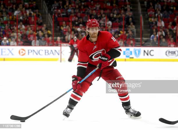 Dougie Hamilton of the Carolina Hurricanes controls the puck on the ice during an NHL game against the Pittsburgh Penguins on March 19 2019 at PNC...