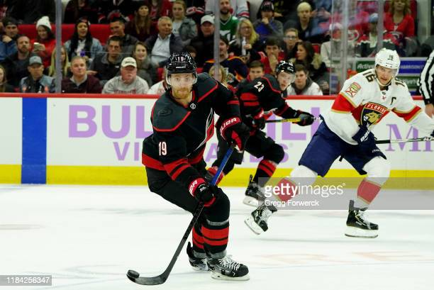 Dougie Hamilton of the Carolina Hurricanes controls the puck on the ice during an NHL game against the Florida Panthers on November 23 2019 at PNC...