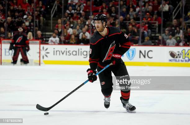 Dougie Hamilton of the Carolina Hurricanes controls the puck on the ice during an NHL game against the Washington Capitals on January 3 2020 at PNC...