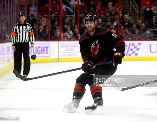 Dougie Hamilton of the Carolina Hurricanes dumps the puck into the zone of during an NHL game against the Anaheim Ducks on November 30 2018 at PNC...