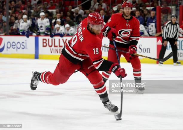 Dougie Hamilton of the Carolina Hurricanes fires a slap shot during an NHL game against the Vancouver Canucks on October 9 2018 at PNC Arena in...