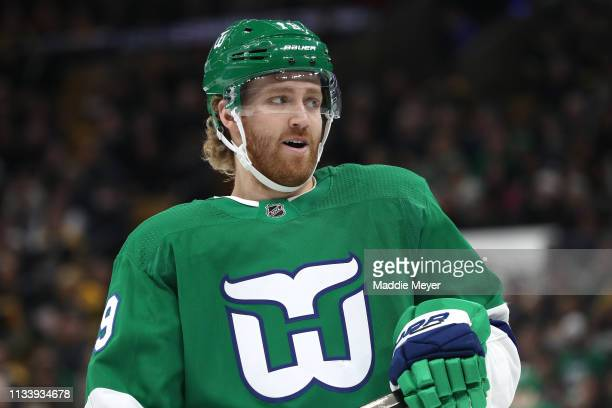 Dougie Hamilton of the Carolina Hurricanes looks on during the first period against the Boston Bruins at TD Garden on March 05 2019 in Boston...