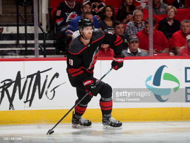Dougie Hamilton of the Carolina Hurricanes looks to pass the puck during an NHL game against the New York Rangers on October 7 2018 at PNC Arena in...
