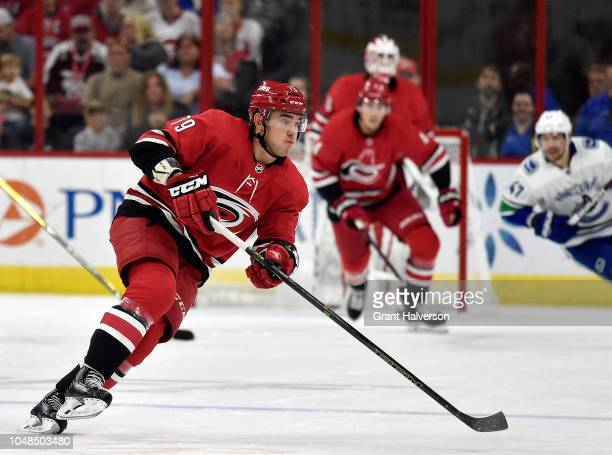 Dougie Hamilton of the Carolina Hurricanes moves the puck against the Vancouver Canucks during their game at PNC Arena on October 9 2018 in Raleigh...