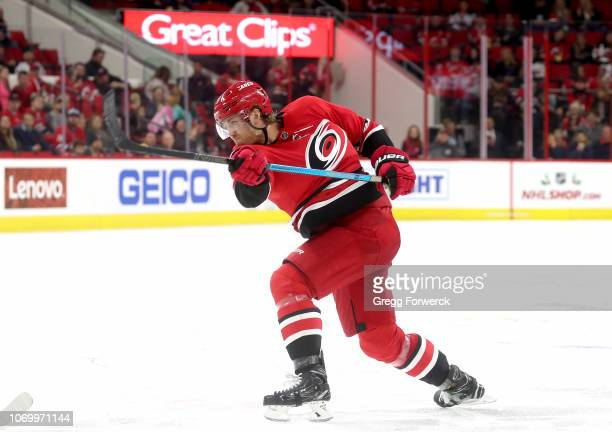 Dougie Hamilton of the Carolina Hurricanes shoots the puck during an NHL game against the New Jersey Devils on November 18 2018 at PNC Arena in...