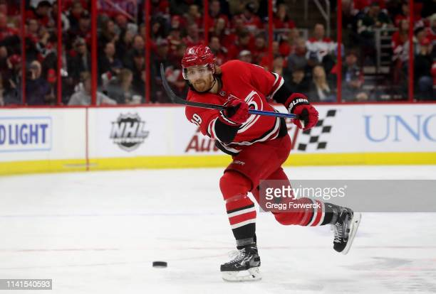 Dougie Hamilton of the Carolina Hurricanes shoots the puck during an NHL game against the Minnesota Wild on March 23 2019 at PNC Arena in Raleigh...