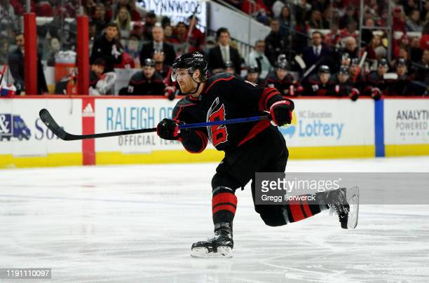 Dougie Hamilton of the Carolina Hurricanes shoots the puck during an NHL game against the Montreal Canadiens on December 31 2019 at PNC Arena in...