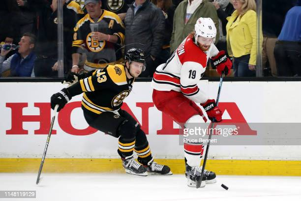 Dougie Hamilton of the Carolina Hurricanes skates against Danton Heinen of the Boston Bruins during the third period in Game One of the Eastern...