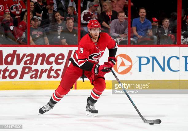 Dougie Hamilton of the Carolina Hurricanes skates with the puck during an NHL game against the New York Islanders on October 4 2018 at PNC Arena in...