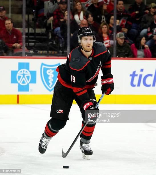 Dougie Hamilton of the Carolina Hurricanes skates with the puck during an NHL game against the Nashville Predators on November 29 2019 at PNC Arena...
