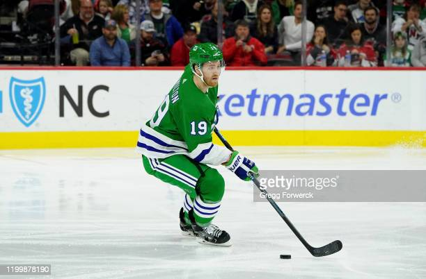 Dougie Hamilton of the Carolina Hurricanes skates with the puck during an NHL game against the Los Angeles Kings on January 11 2020 at PNC Arena in...