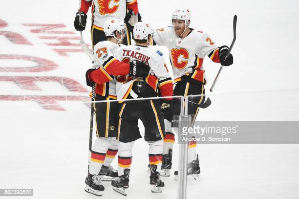 Dougie Hamilton Sean Monahan and Matthew Tkachuk of the Calgary Flames celebrate a goal during a game against the Los Angeles Kings at STAPLES Center...