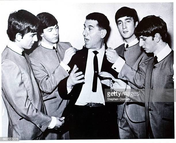 Dougie Millings center tailor and confidante to the Beatles Millings designed their famous collarless jackets A Handout photo of the Beatles and...