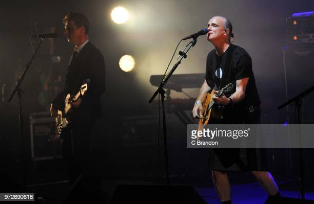 Fran Healy and Andy Dunlop of Travis perform on stage at the Royal Festival Hall on June 12 2018 in London England
